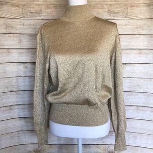 Tesoro gold turtleneck sweater.